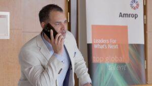 Amrop employee talks on the phone
